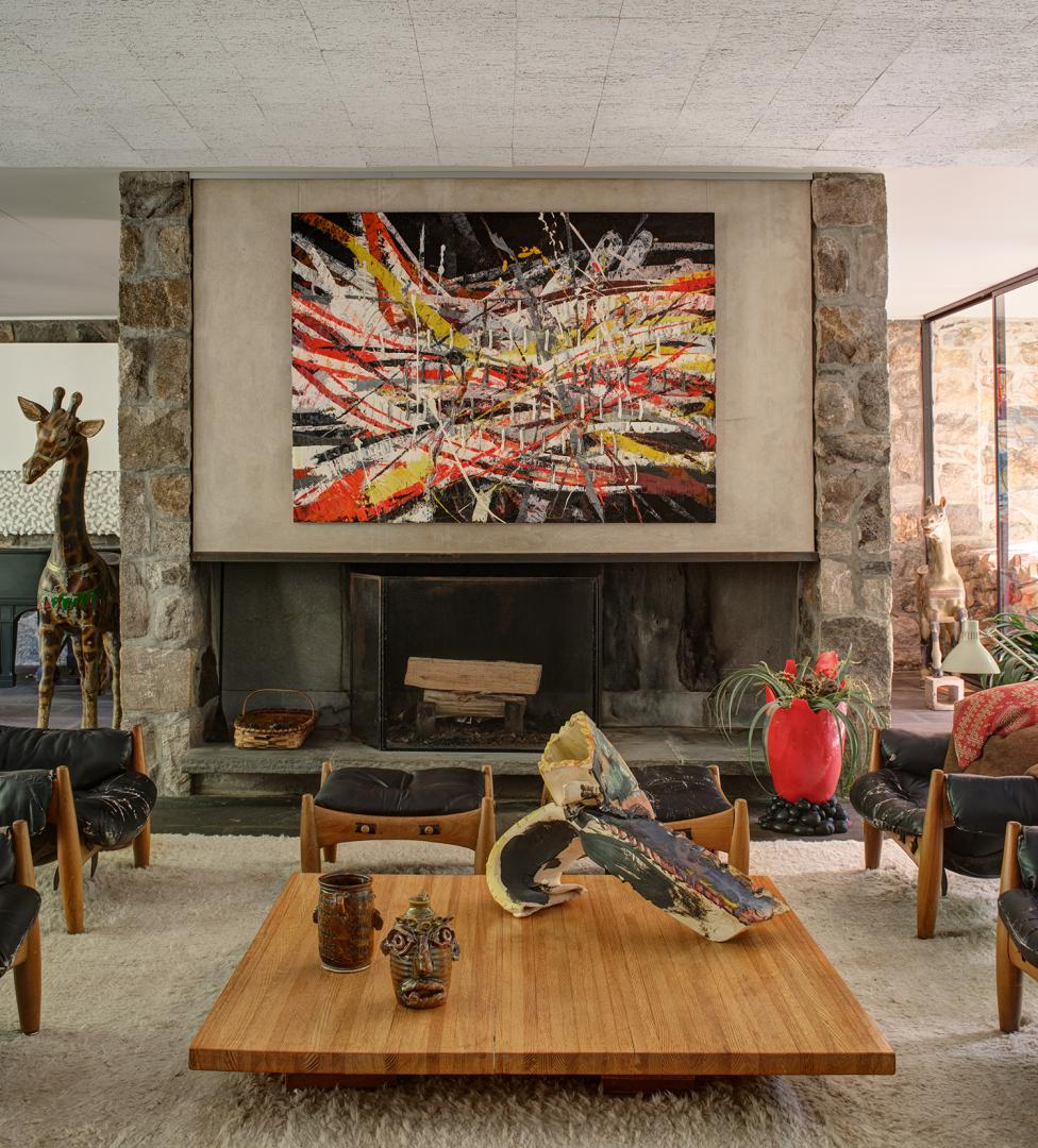 At The Noyes House: Blum & Poe, Mendes Wood DM and Object & Thing. The Noyes House, New Canaan, Connecticut. Photo by Michael Biondo. Works pictured [left to right]: Mark Grotjahn, Untitled (Capri 53.16) (2020); Gaetano Pesce, Large Red Pebble Vase (2016); Coffee table: Jim McDowell, Madison Washington (2017) and Love Trumps Hate (2019); Lynda Benglis, AMAXA (2013).