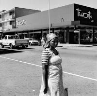 "David Goldblatt, On the corner of Commissioner and Eloff Streets, 1979. Vintage gelatin silver hand print, 11"" × 11"" (27.9 cm × 27.9 cm), image unique. © The David Goldblatt Legacy Trust."