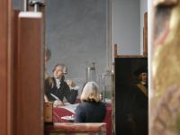 Conservator Dorothy Mahon working on Jacques Louis David's Portrait of Antoine-Laurent and Marie Anne Lavoisier at The Met Museum, New York. Credit: Eddie Knox © Oxford Films, 2021. Image courtesy PBS.