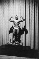 Diane Arbus, <em>Kenneth Hall, the new Mr. New York City, at a physique contest, N.Y.C.</em>, 1959. Gelatin silver print. © The Estate of Diane Arbus