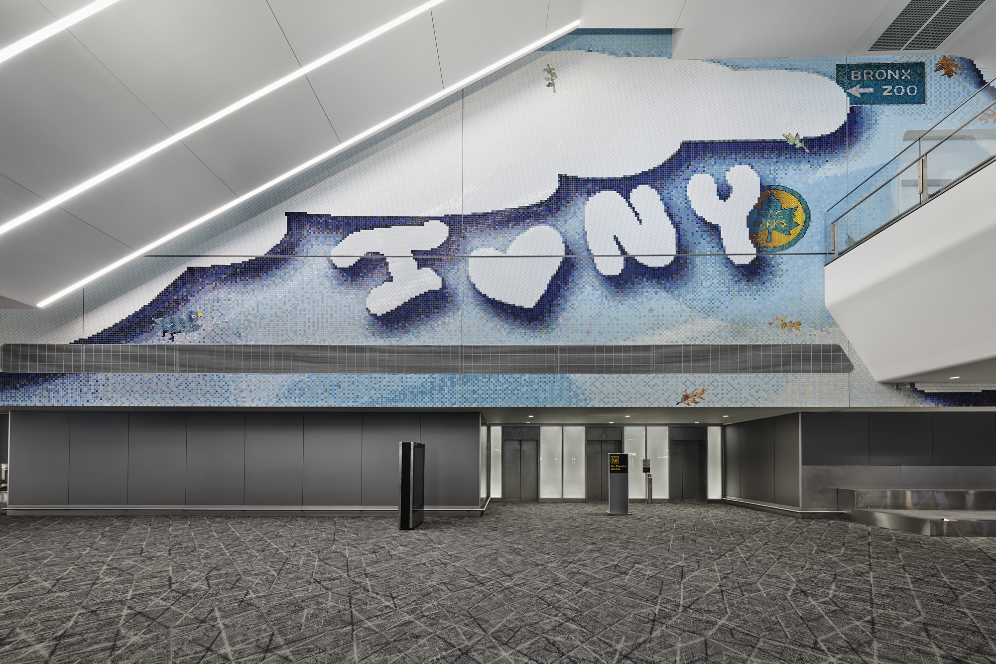 """Laura Owens, """"I [pizza emoji] NY,"""" 2020. Handmade glazed ceramic tiles and grout. Commissioned by LaGuardia Gateway Partners in partnership with Public Art Fund for LaGuardia Airport's Terminal B. Courtesy of the artist; Gavin Brown's Enterprise, New York, Rome; Sadie Coles HQ, London; and Galerie Gisela Capitan, Cologne. Photo: Tom Powel Imaging"""
