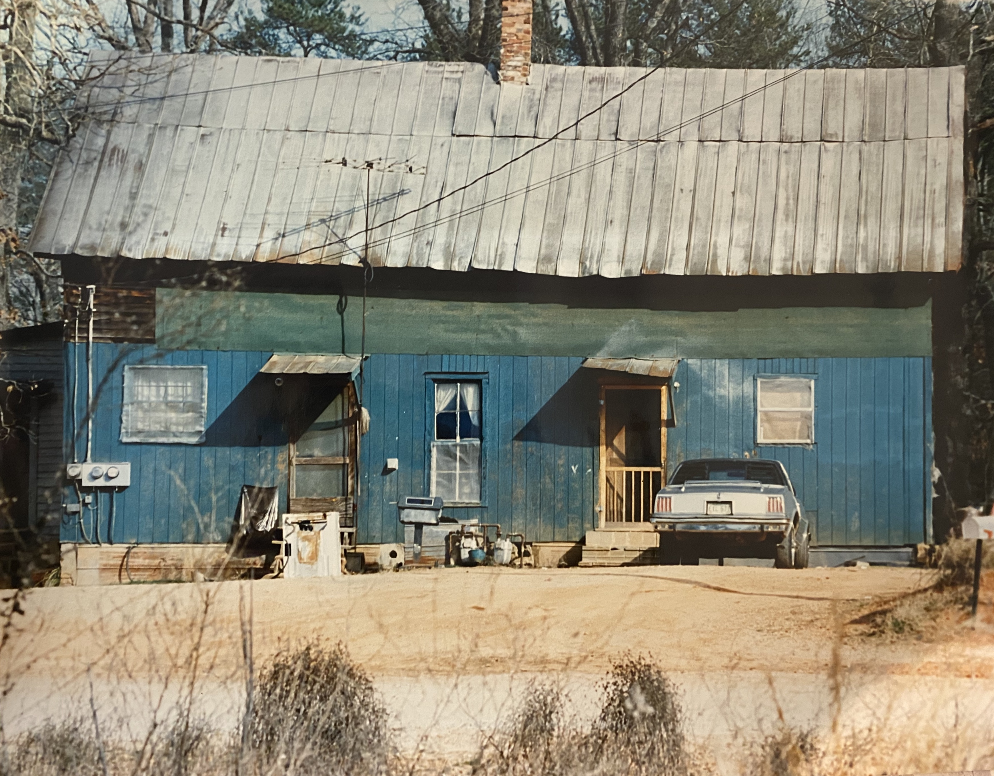 Beverly Buchanan, Saddlebag House Clarke County, Georgia, n.d.. Color photograph, 16 x 20 inches. Image courtesy Andrew Edlin gallery, New York.