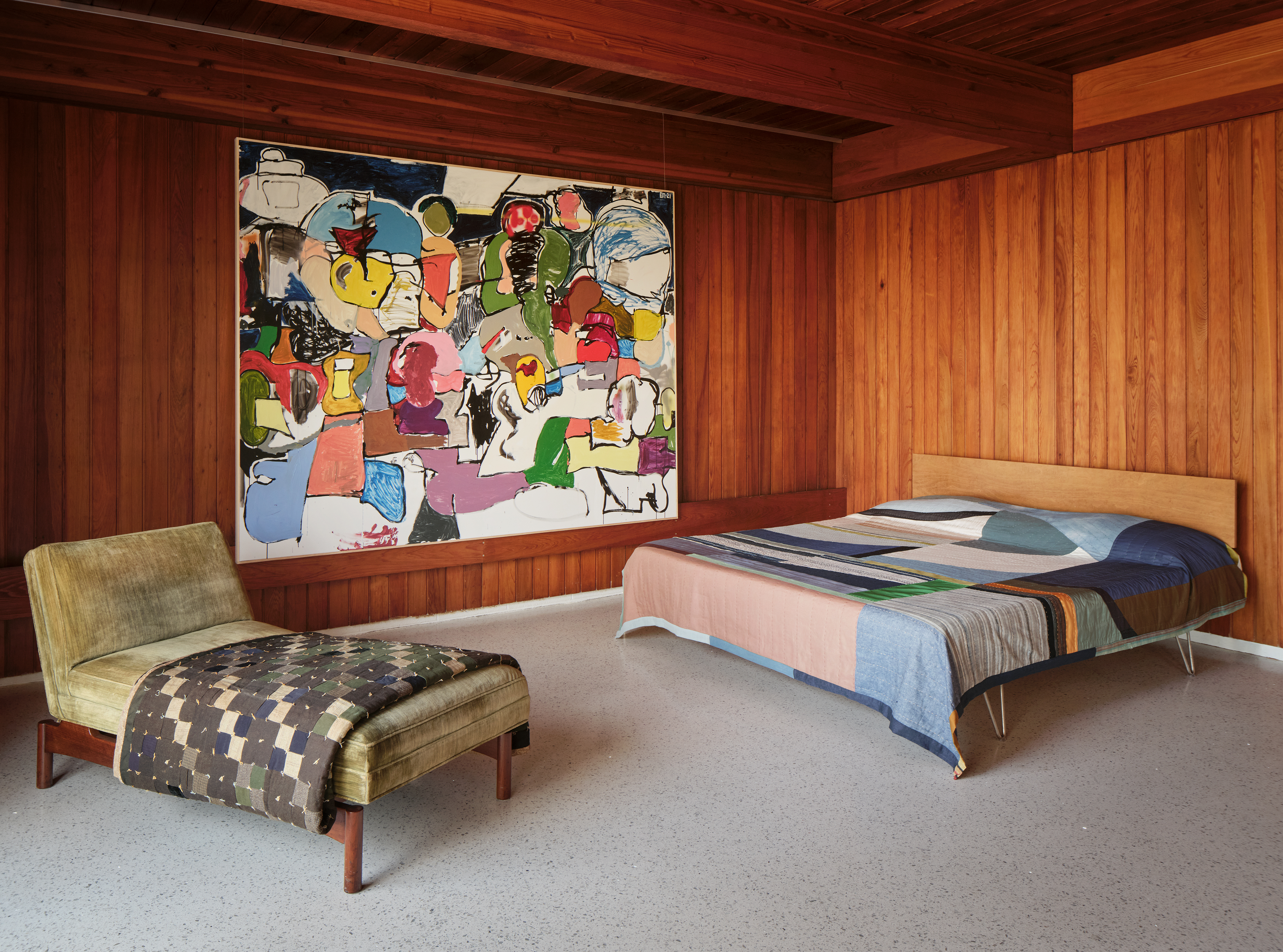 At The Luss House: Blum & Poe, Mendes Wood DM and Object & Thing. The Gerald Luss House, Ossining, New York. Photo by Michael Biondo. Works pictured [left to right]: Gerald Luss, Chaise for Lehigh Furniture Company (c. 1950s); Eddie Martinez, Ideal Location (2021); Kiva Motnyk, Botanic Study - Indigo (2021).