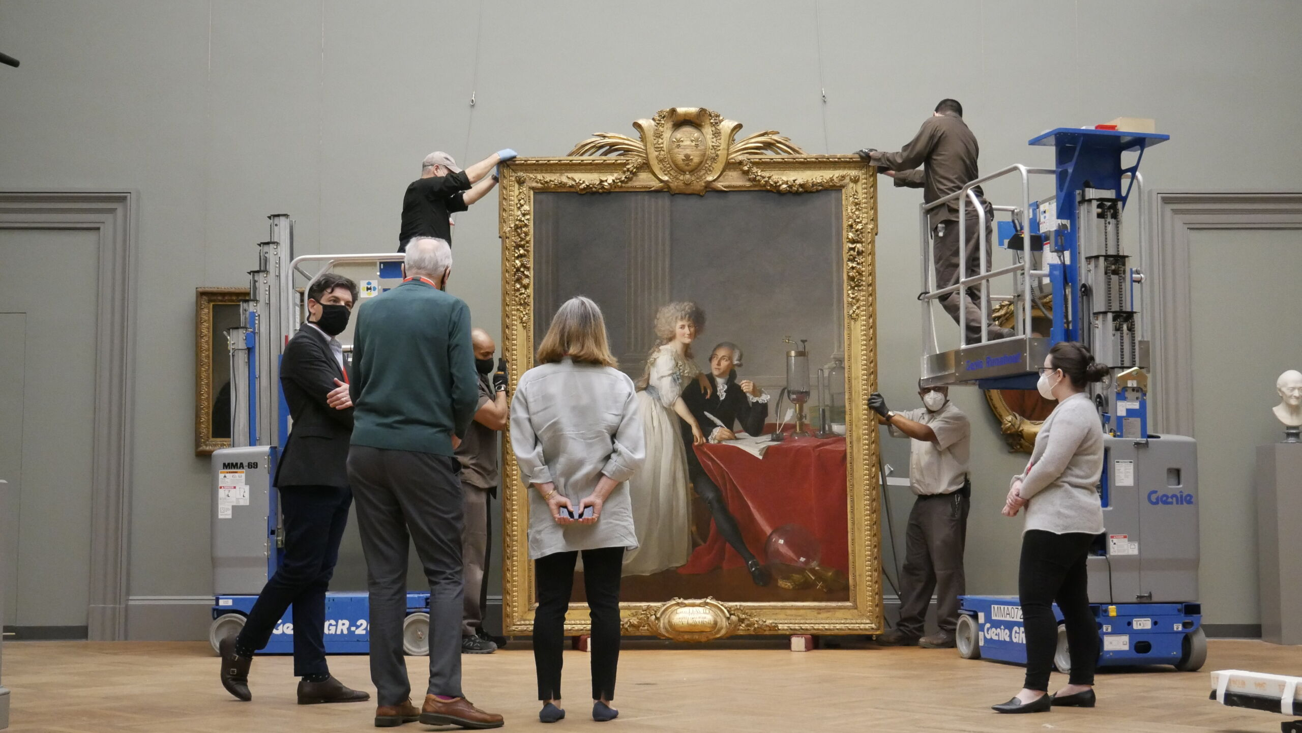 The hanging of Jacques Louis David's Portrait of Antoine-Laurent and Marie Anne Lavoisier at The Met Museum, New York. Credit: Eddie Knox © Oxford Films, 2021. Image courtesy PBS.