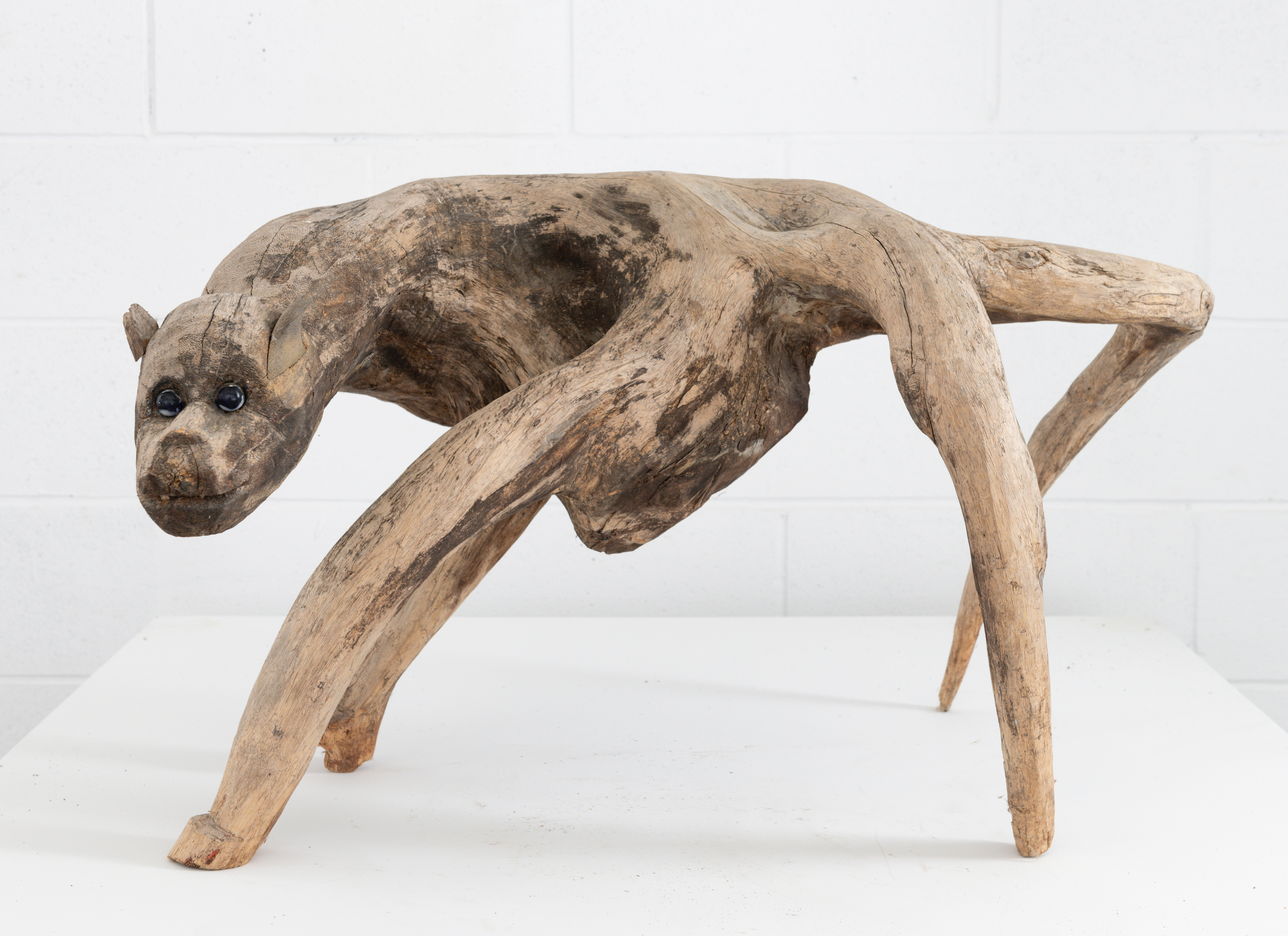 Unknown Artist, Root Carved Dog, Late 20th Century. Wood, marble. 17 x 24 x 27 inches. Courtesy NEXUS SINGULARITY (Aarne Anton)