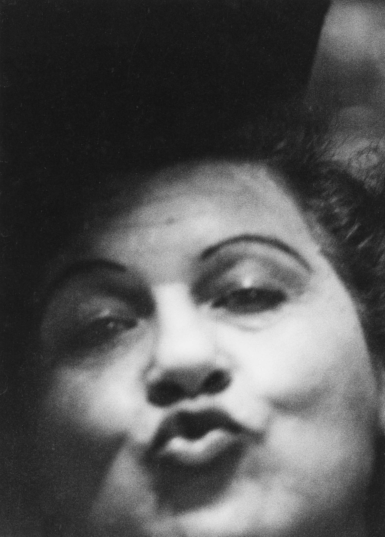 Diane Arbus, <em>Woman making a kissy face, Sammy's Bowery Follies, N.Y.C.</em>, 1958. Gelatin silver print. © The Estate of Diane Arbus