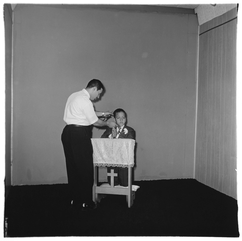 Diane Arbus, <em>Photographer posing communion boy, N.Y.C.</em>, 1968. Gelatin silver print. © The Estate of Diane Arbus