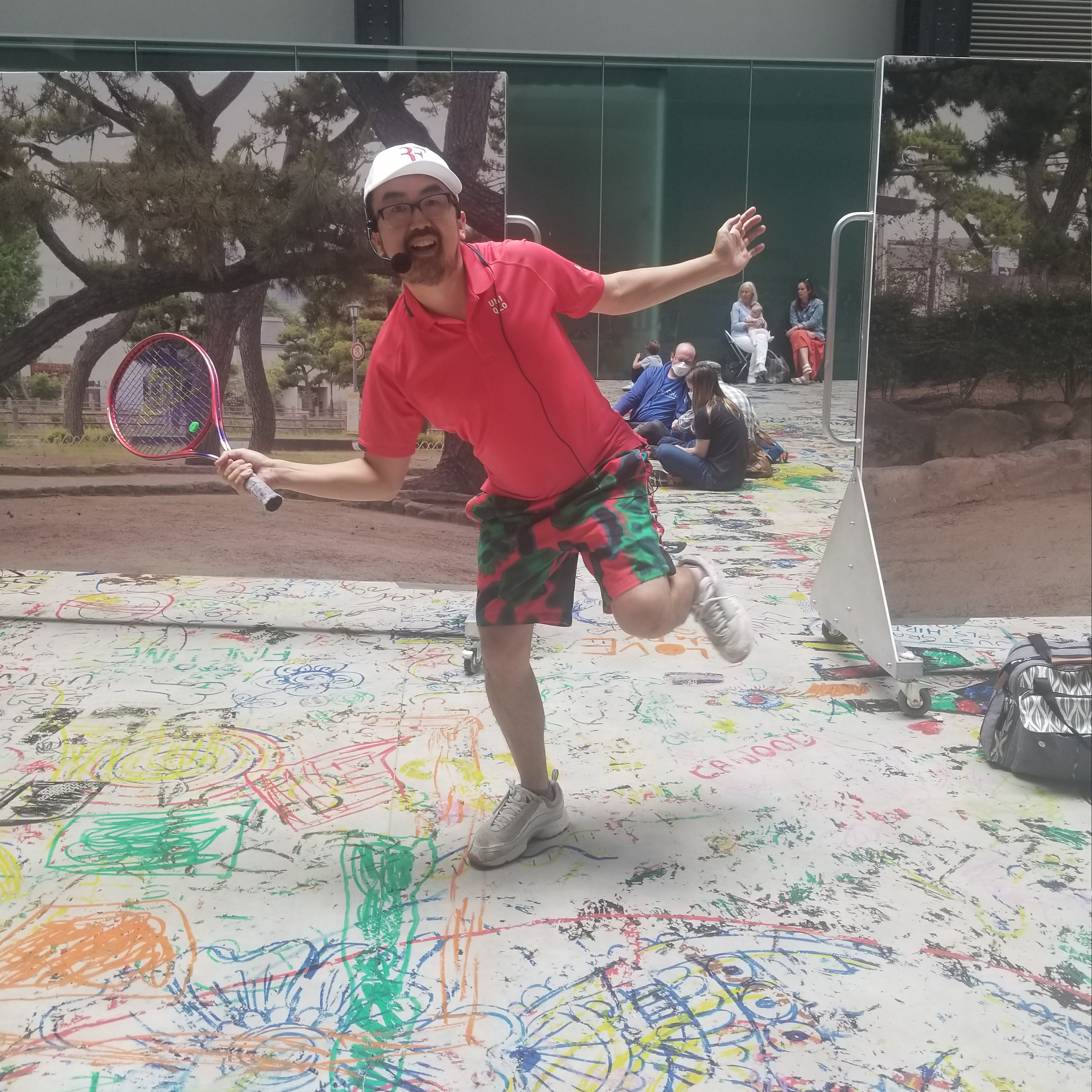Ei Arakawa performing _Mega Please Draw Freely_ at Tate Modern, summer 2021.