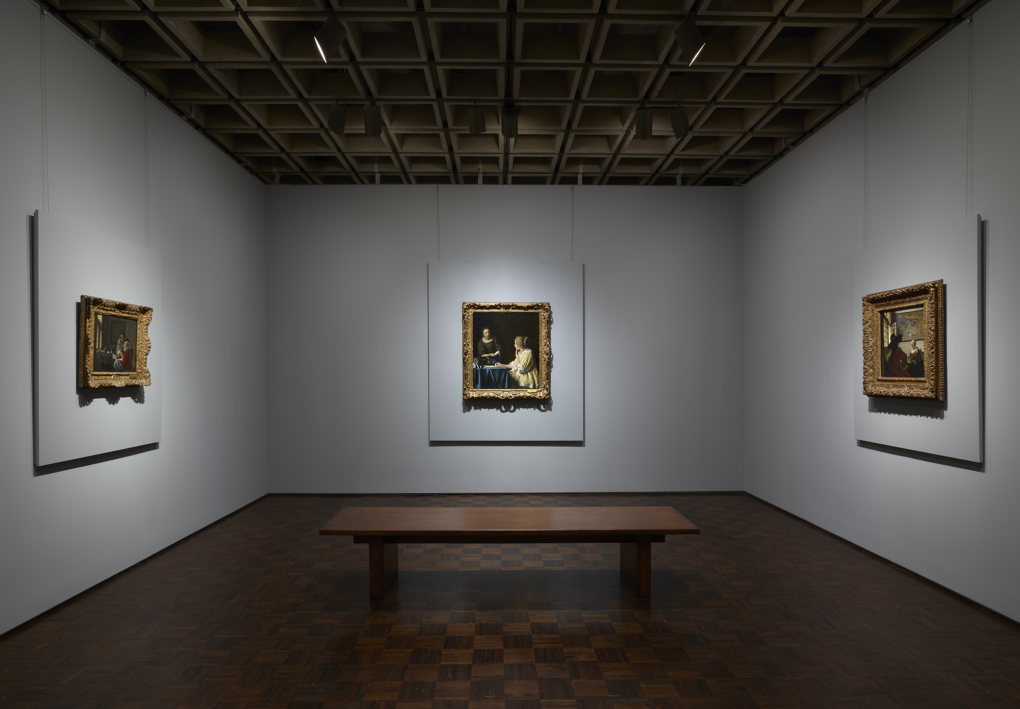 Three paintings by Vermeer (from left, Girl Interrupted at Her Music, Mistress and Maid, and Officer and Laughing Girl) as shown at Frick Madison by The Frick Collection; photo: Joe Coscia