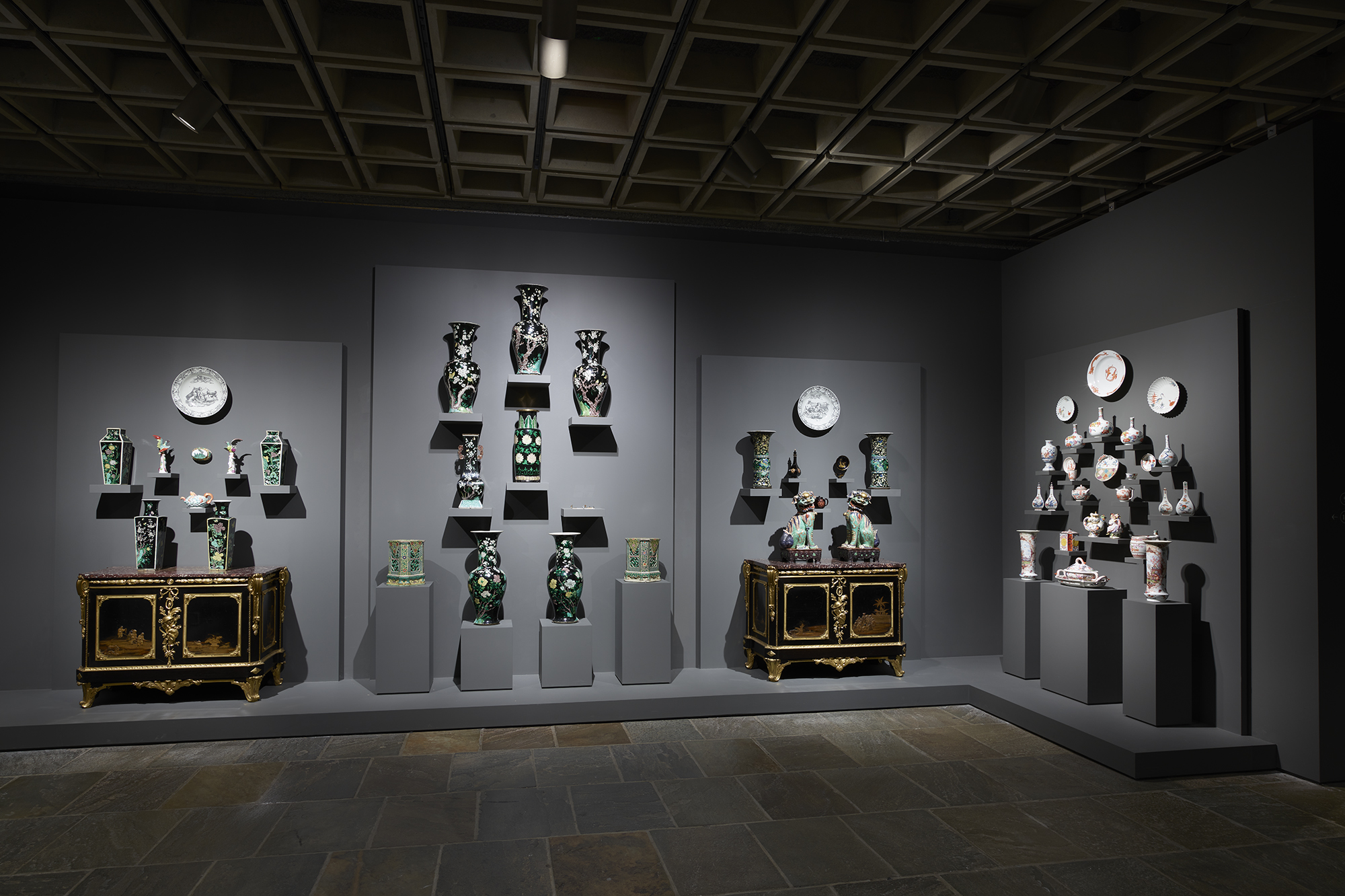 A dramatic display of European and Asian porcelain (ca. 1500–ca. 1900) is featured in this Frick Madison room, reflecting deep cultural interaction in the history of the medium. Remarkable examples of eighteenth-century French furniture from The Frick Collection are also shown; photo: Joe Coscia