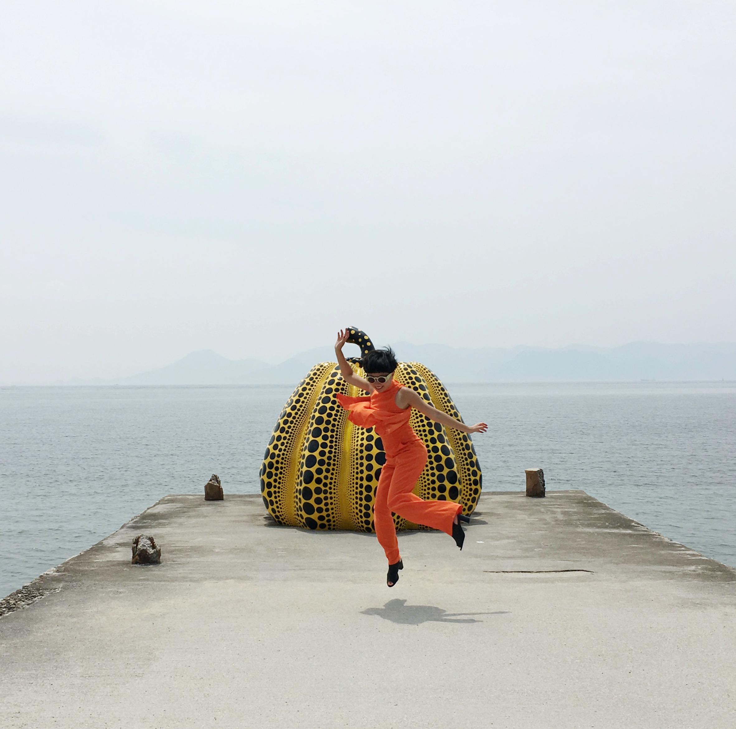 Fei with Yayoi Kusama's Pumpkin on Naoshima Island, Japan, 2017