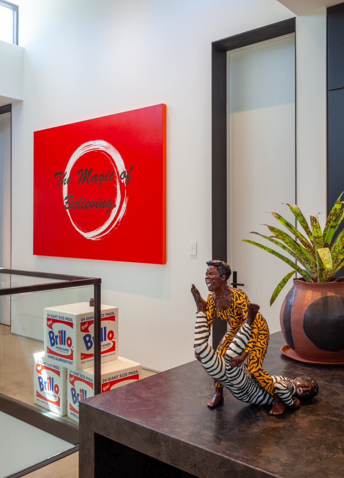Mickalene Thomas, Brawlin' Spitfire Wrestlers, 2008 (sculpture), and The Magic of Believing, 2014 (painting), in the Gupta Moss collection, Chicago.