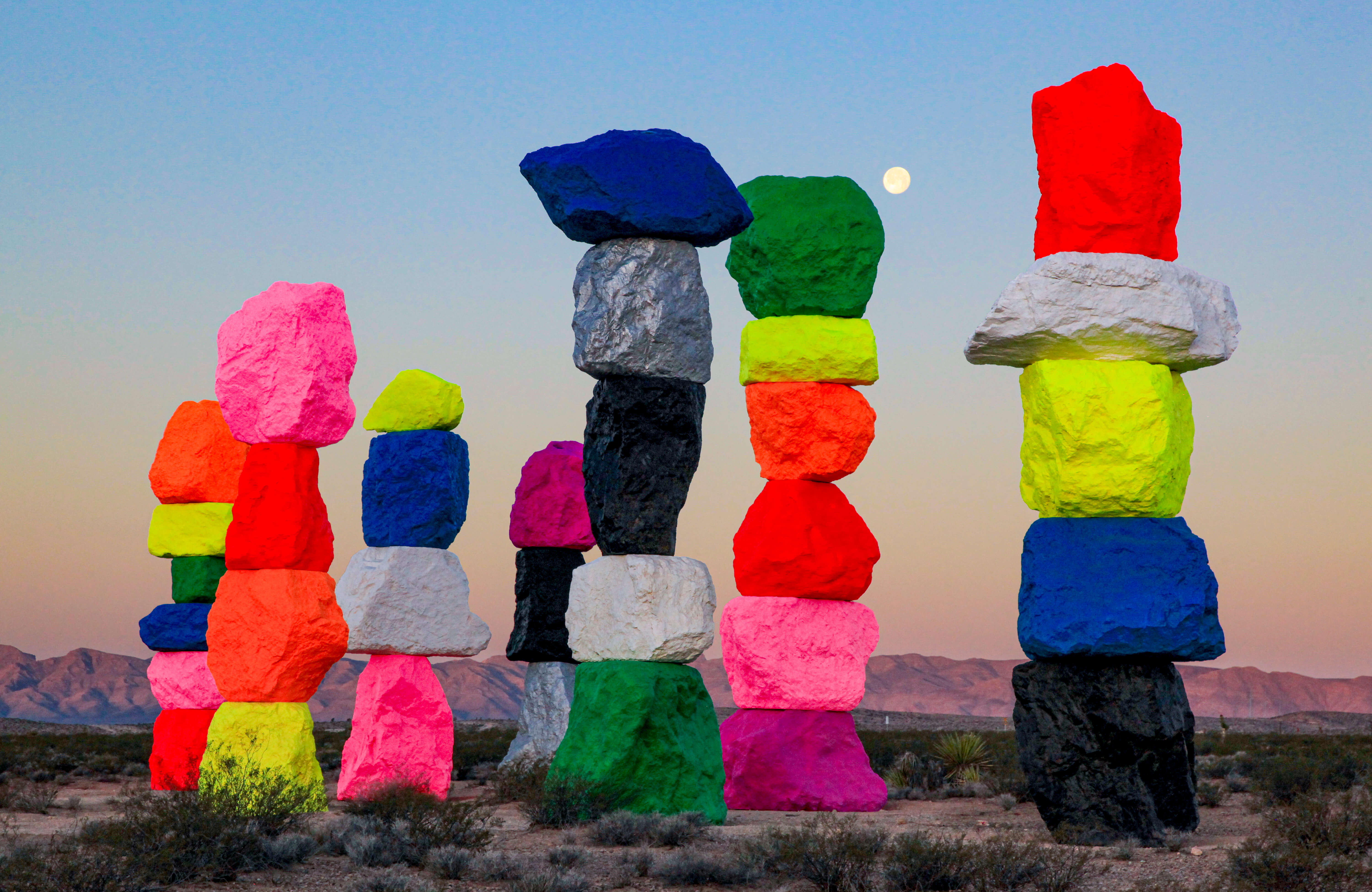 Gianfranco Gorgoni, _Ugo Rondinone's Seven Magic Mountains, near Jean Dry Lake, Nevada_, 2016. Chromogenic print. Photograph from the Collection of the Nevada Museum of Art, The Altered Landscape, Carol Franc Buck Collection, with additional support from the Estate of Nancy L. Peppin; Photograph © Estate of Gianfranco Gorgoni; Artwork co - produced and presented by the Nevada Museum of Art and Art Production Fund; Artwork © Ugo Rondinone.