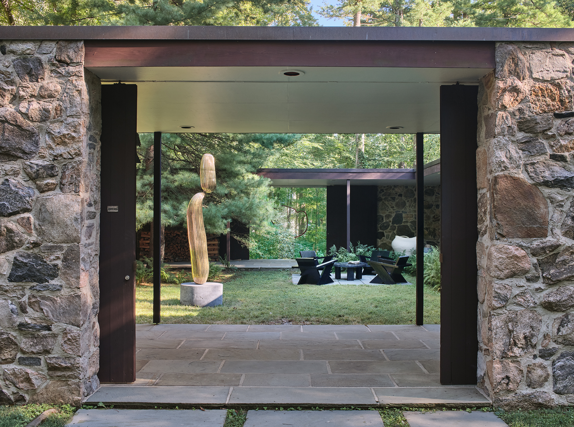 At The Noyes House: Blum & Poe, Mendes Wood DM and Object & Thing. The Noyes House, New Canaan, Connecticut. Photo by Michael Biondo. Works pictured [left to right]: Alma Allen, Not Yet Titled (2020); Daniel Steegmann Mangrané, Untitled (2020); Green River Project LLC, Pine Outdoor Coffee Table and Pine-Board Deck Chairs (2020); Kazunori Hamana, Untitled (2019).