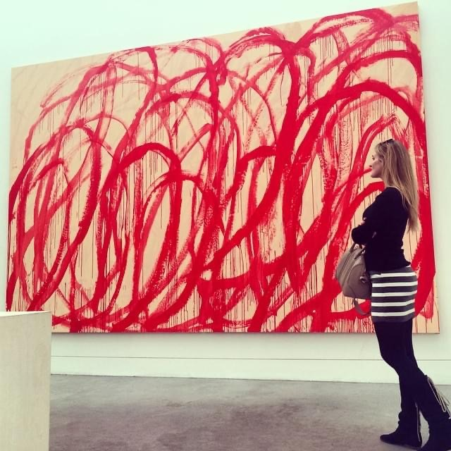 Sarah Arison with a painting by Cy Twombly, at Tate Modern in 2015.